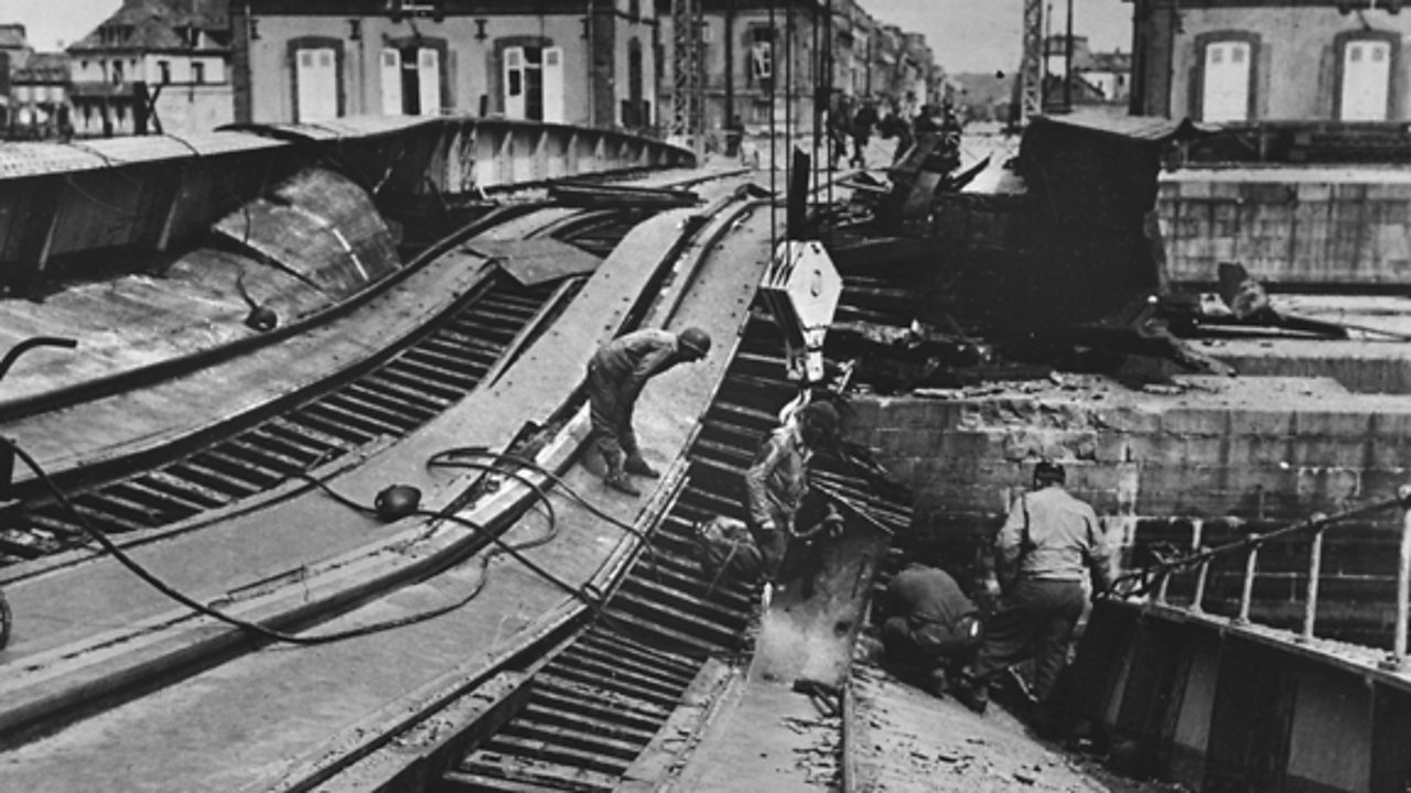 A photograph of a damaged German railway line.