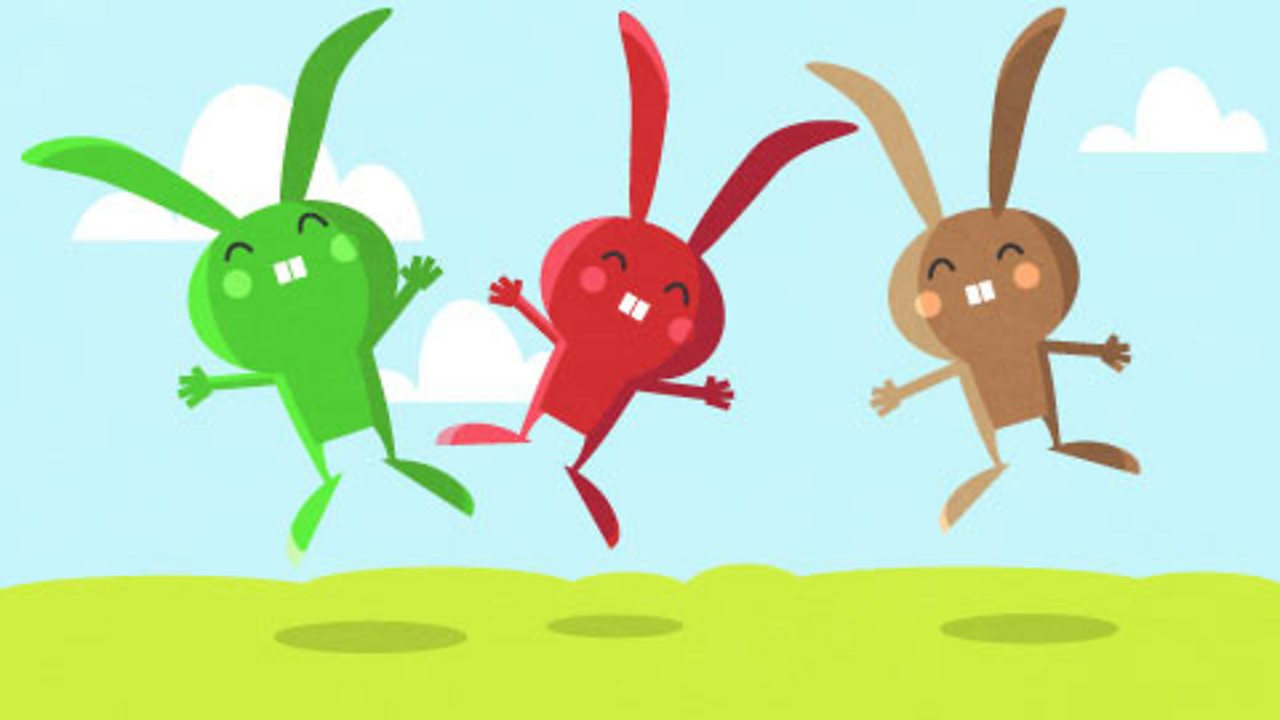 Three illustrated rabbits, each a different colour.