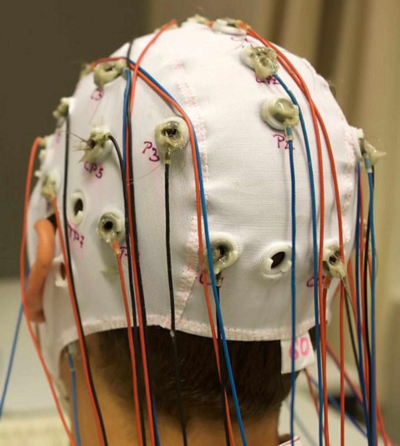 Photograph of man with an electroencephalogram (EEG) on his head.