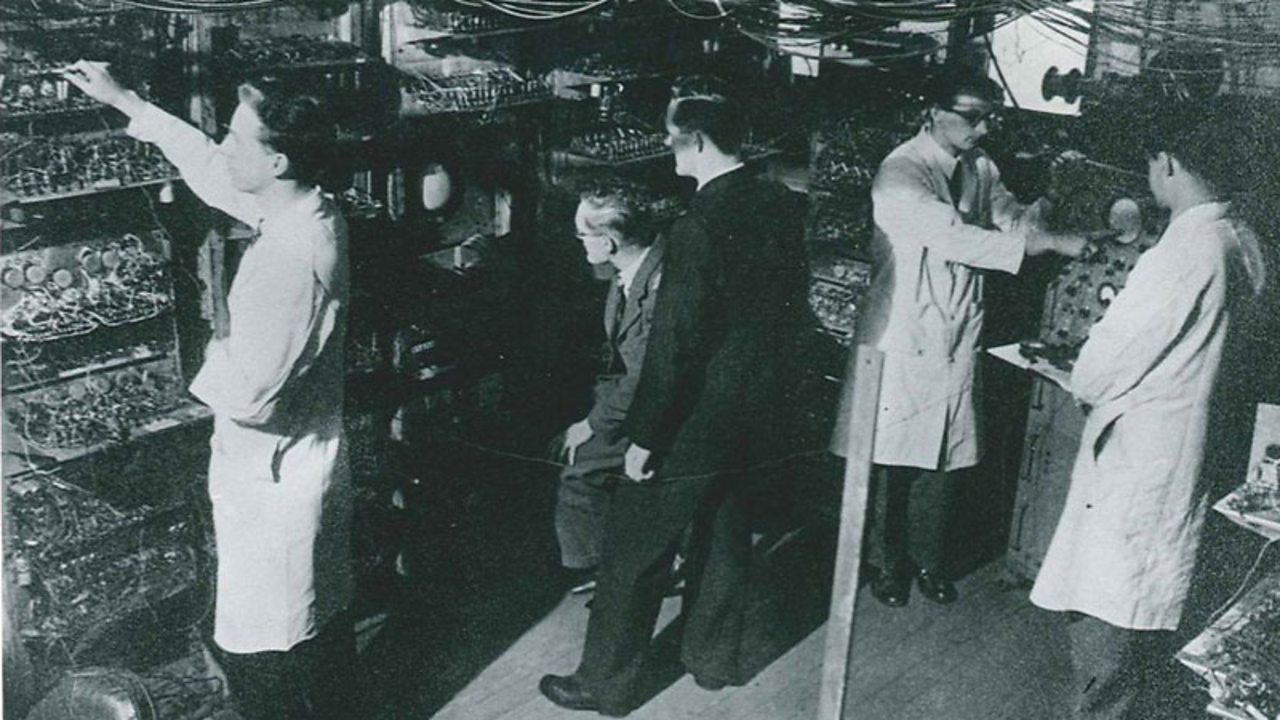 A team of scientists work on the Baby – formally known as the Manchester Small-Scale Experimental Machine.