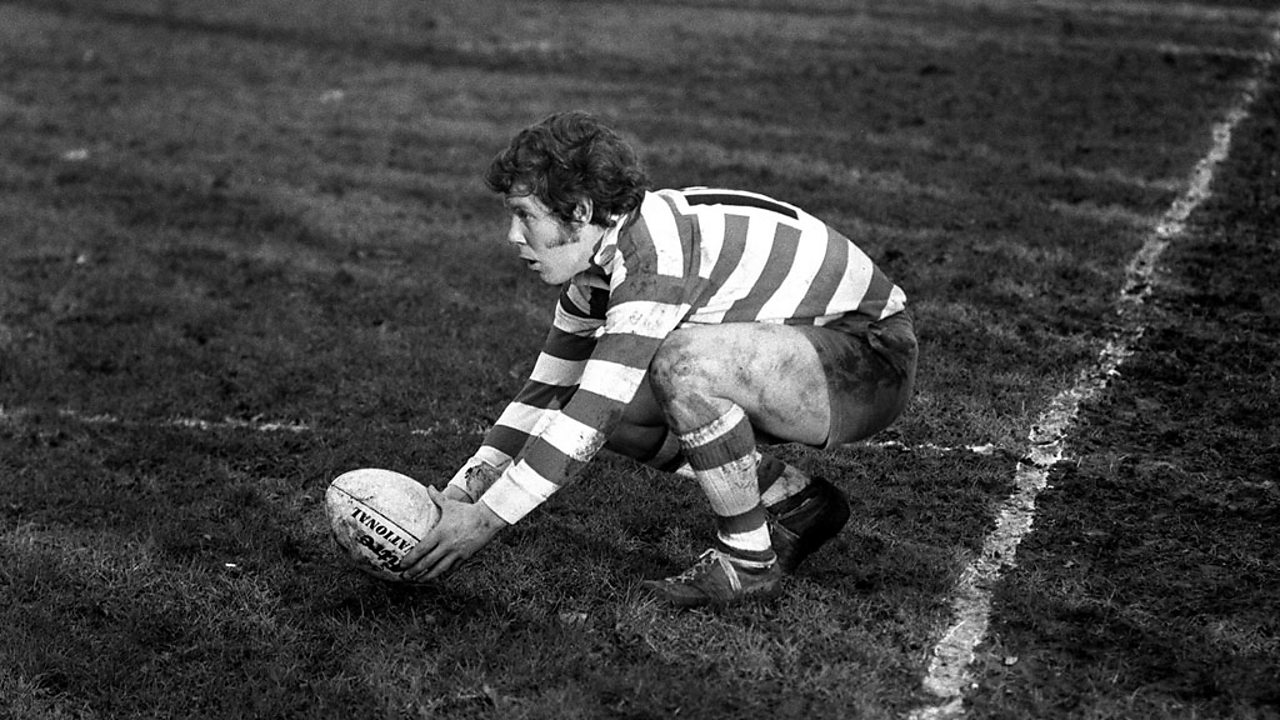 Player placing the ball on a lump of soil dug from the pitch with the heel of the boot.