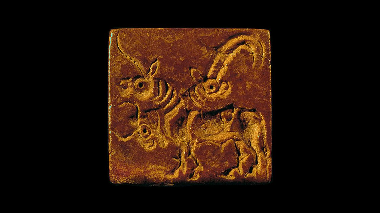 An Indus seal showing a three-headed animal