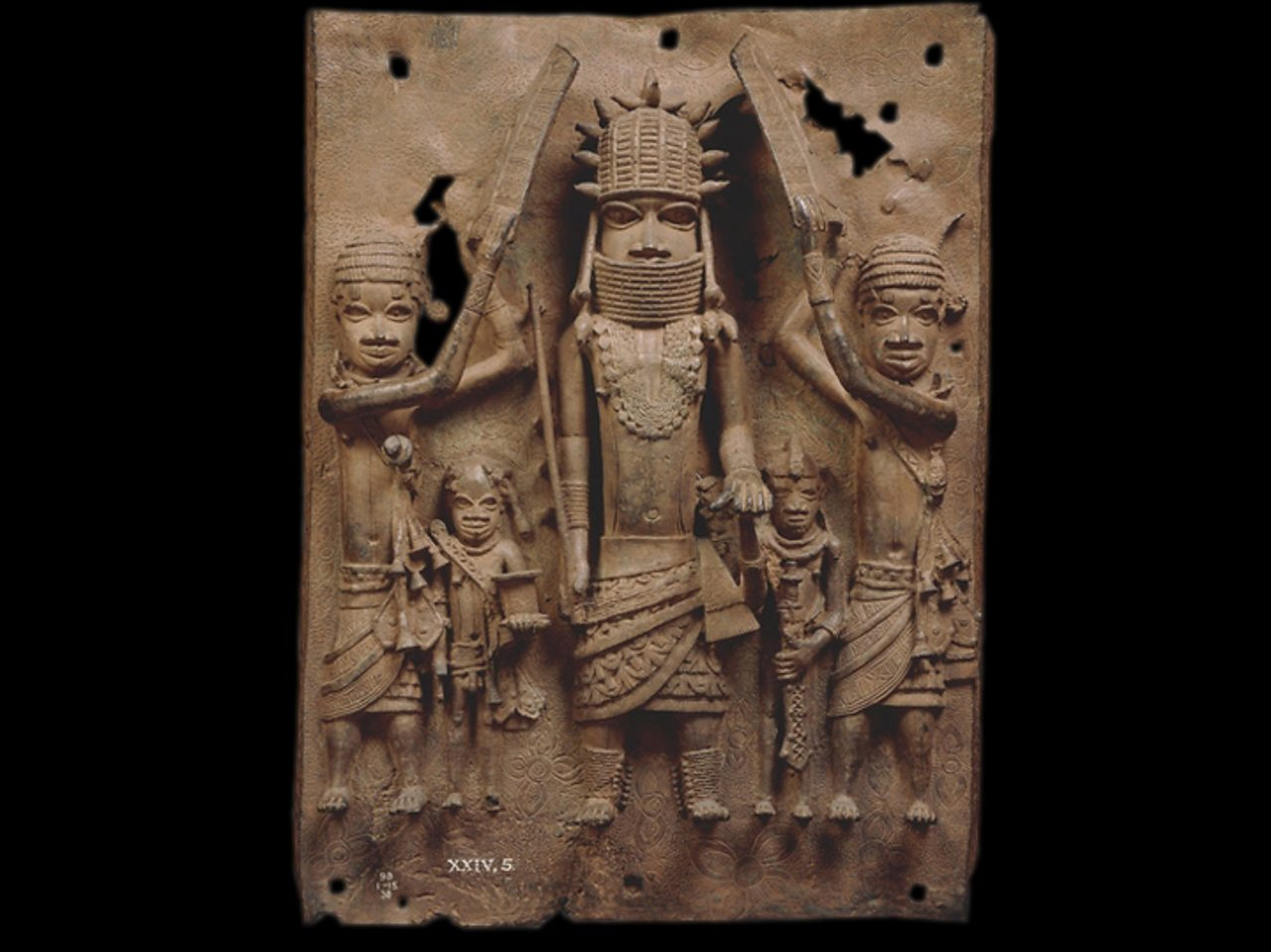 A brass plaque showing an Oba with his attendants.