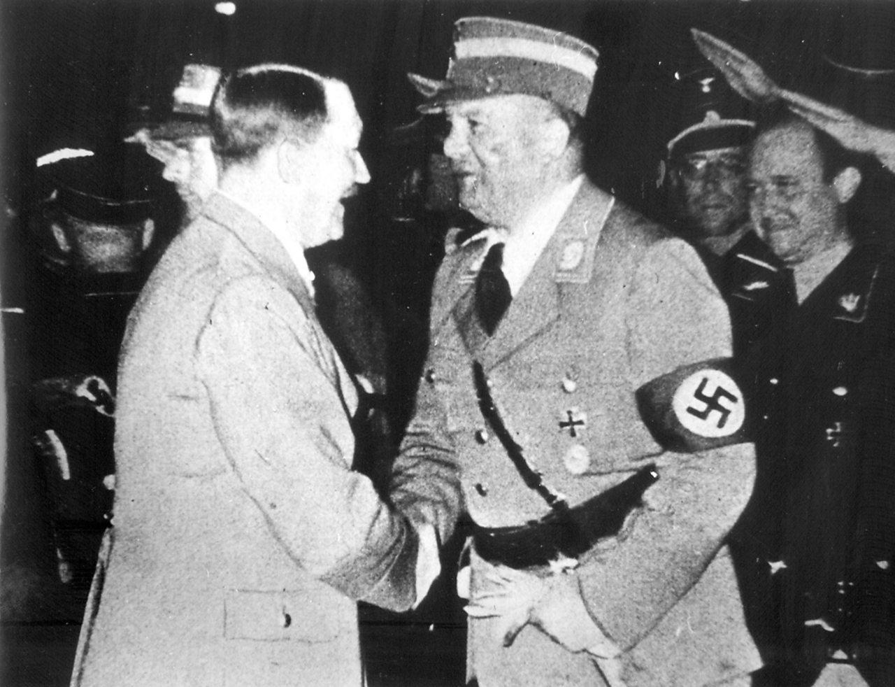 Adolf Hitler greets SA leader Ernst Röhm