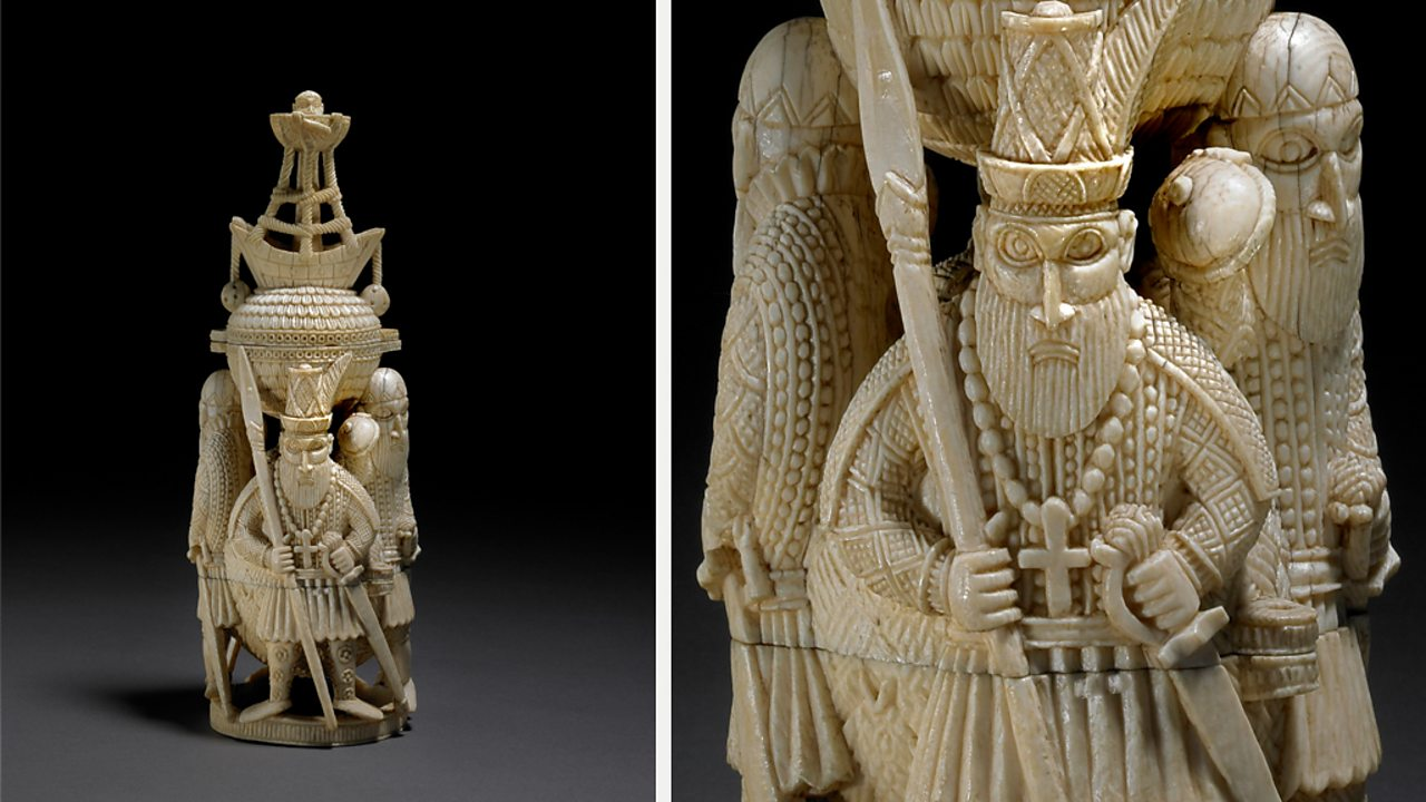 A carved ivory salt container showing merchants