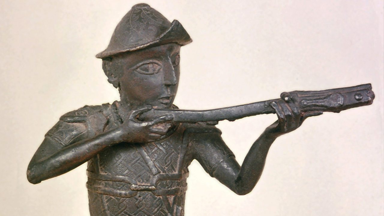 A brass figurine showing a soldier with a gun