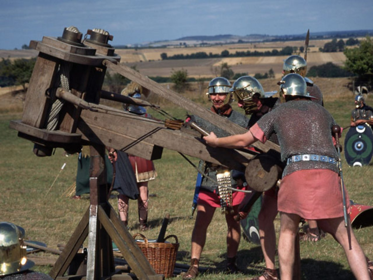 Roman soldiers firing a catapult.
