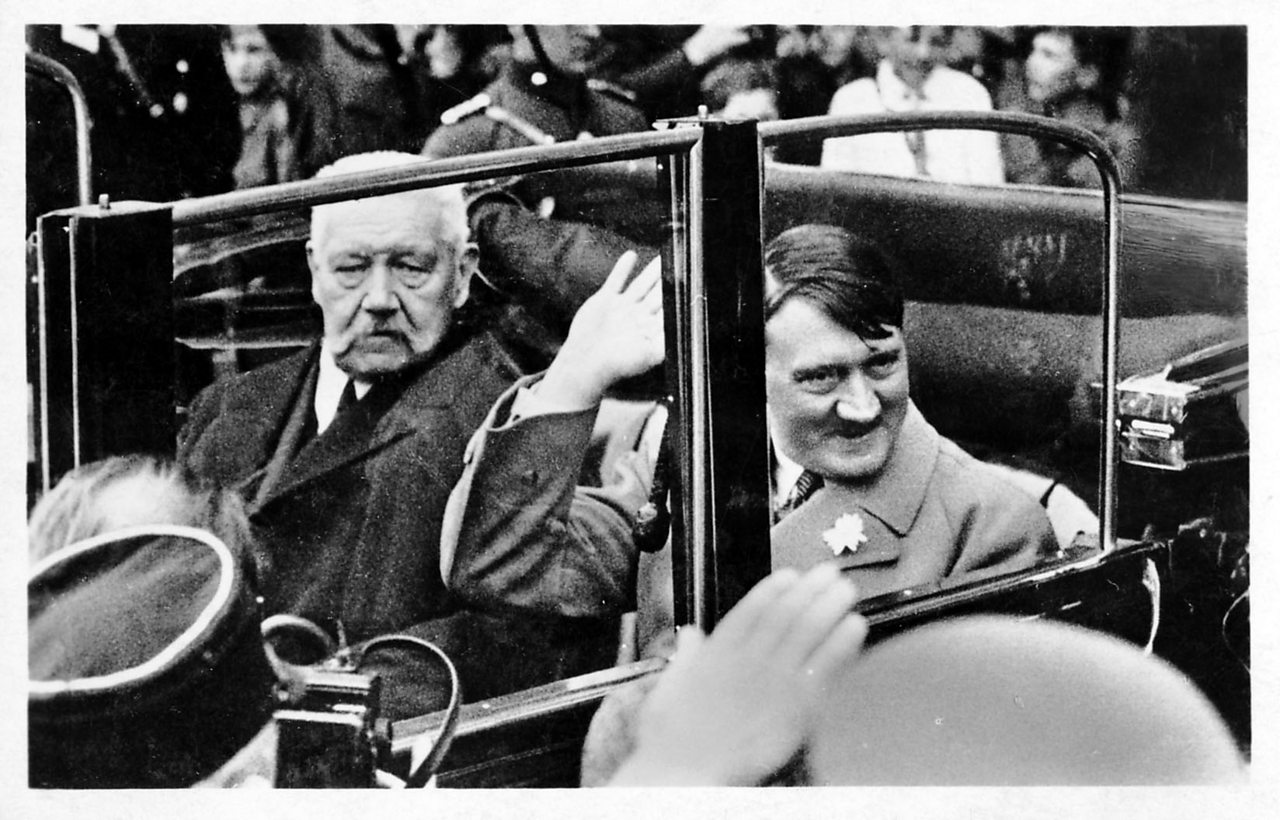 German President Paul von Hindenburg in a car with Nazi leader and Chancellor of Germany, Adolf Hitler in Berlin.