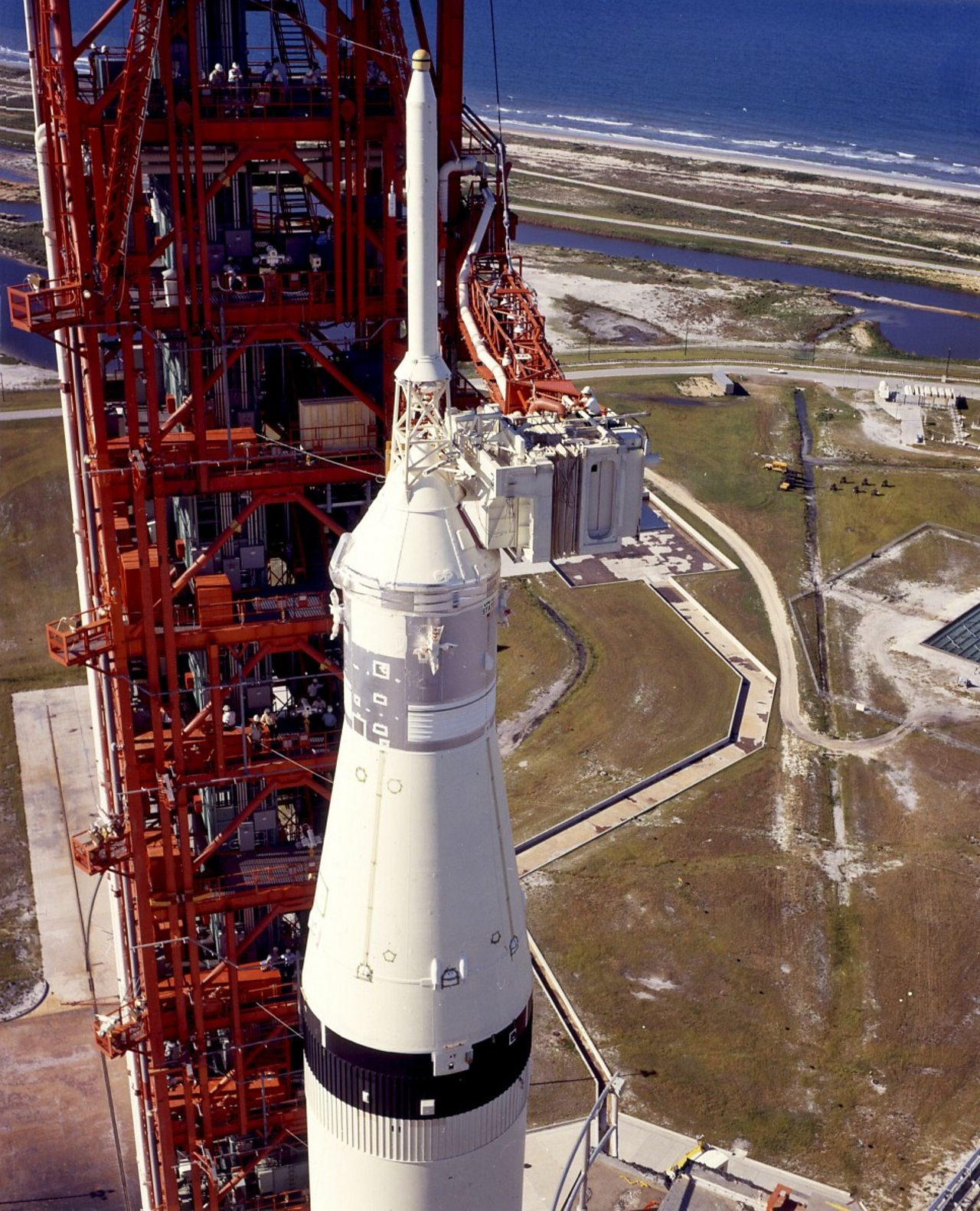 Technicians working on the Saturn V before launch.