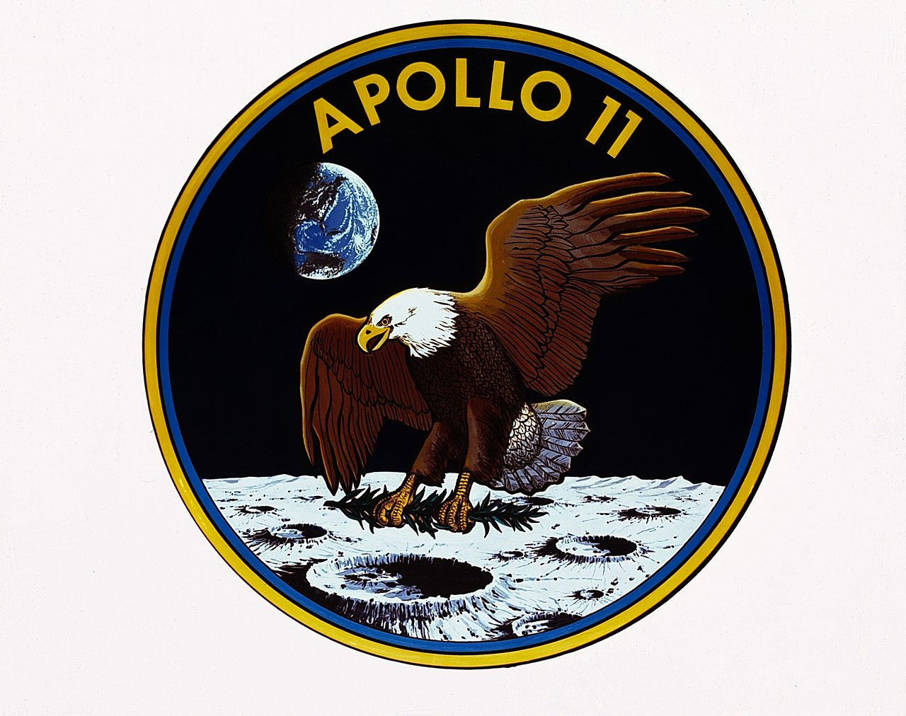 The Apollo 11 mission badge showing an eagle on the moon.