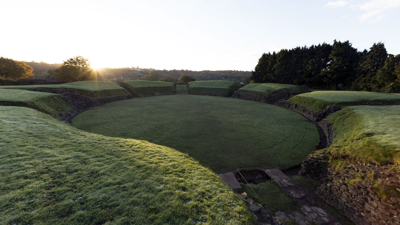 The Roman amphitheatre in Caerleon, which is covered by grass.