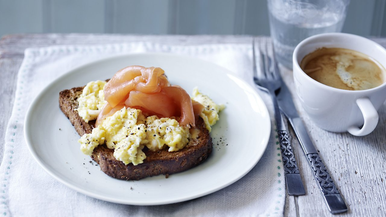 Photograph of scrambled eggs and smoked salmon on wholemeal toast.