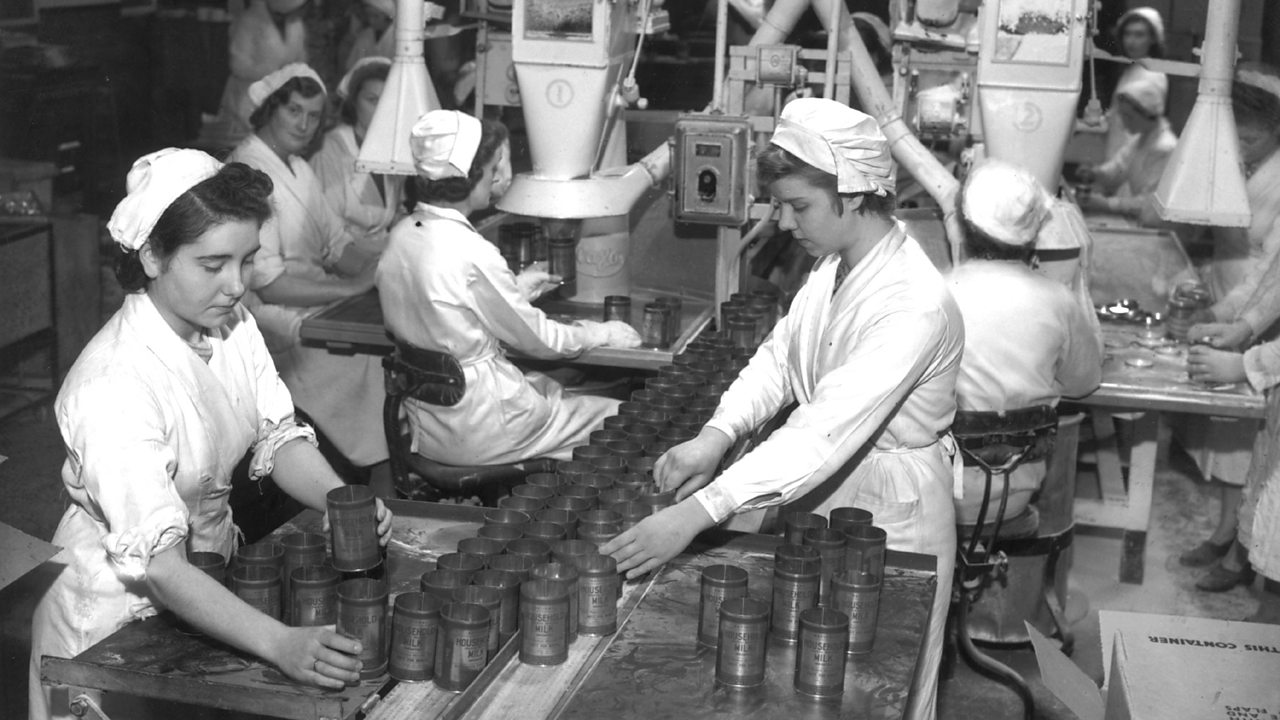 Women working in a food factory, preparing fro VE day.