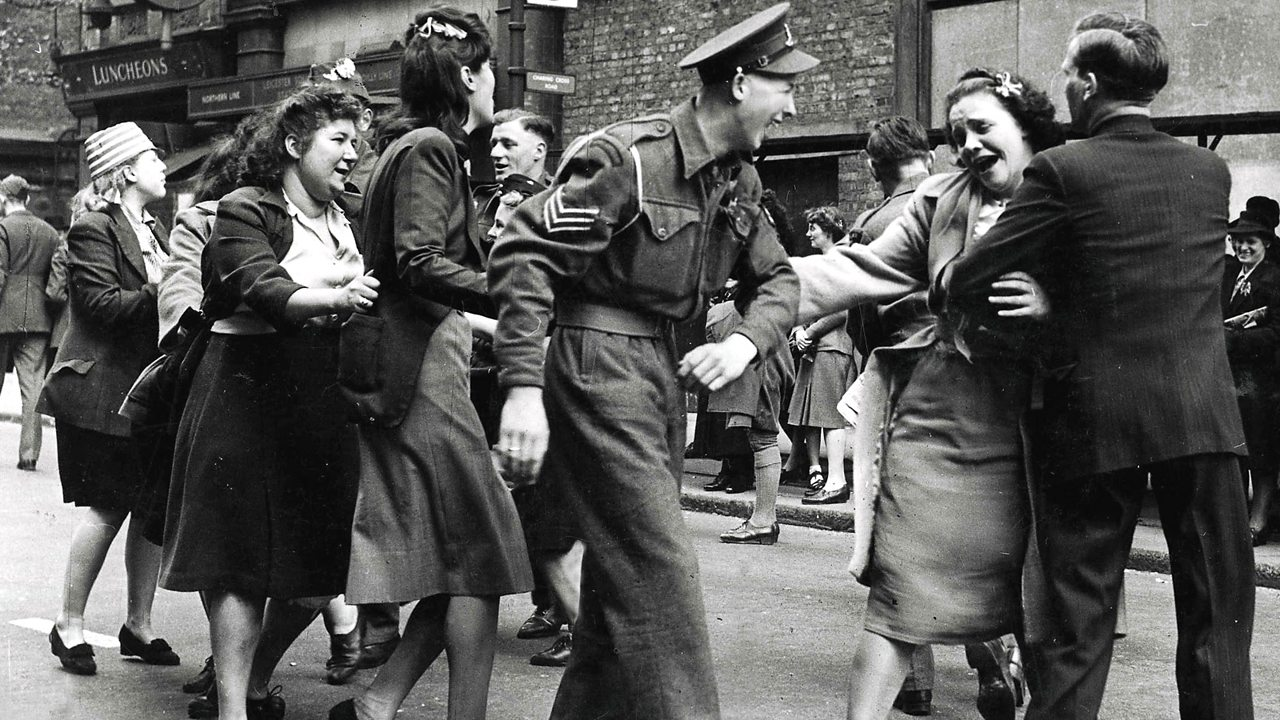 Soldiers and sailors doing the conga through the streets of London