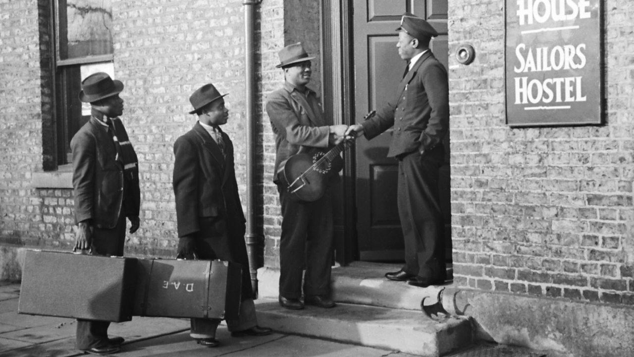 Caribbean men outside a sailor's hostel