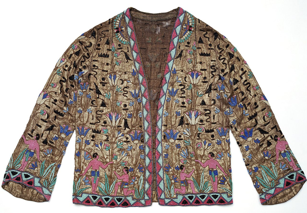 Ornate jacket featuring illustrations inspired by Ancient Egypt.