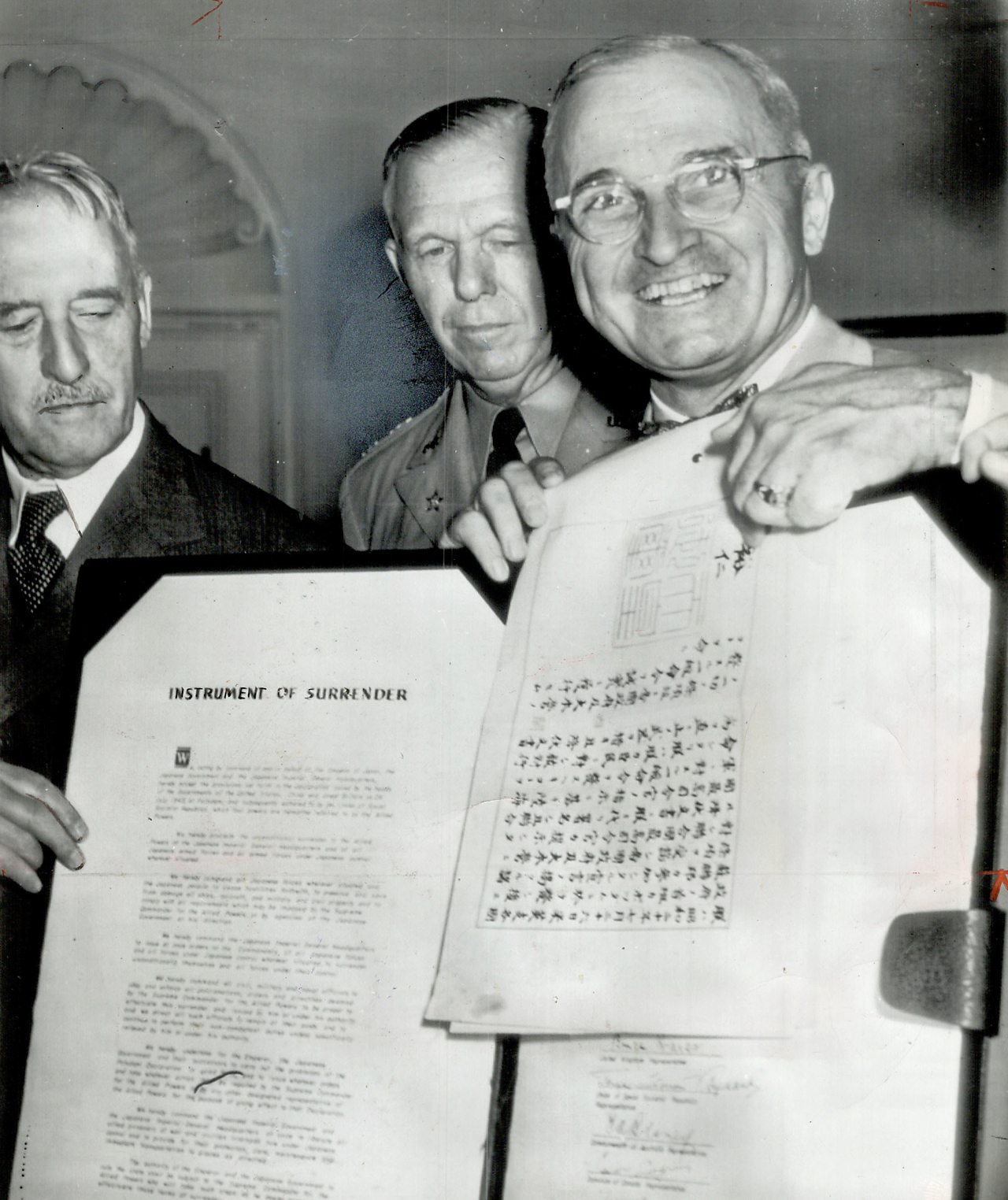 President Truman indicating Hirohito's signature, authorising Japan's surrender.