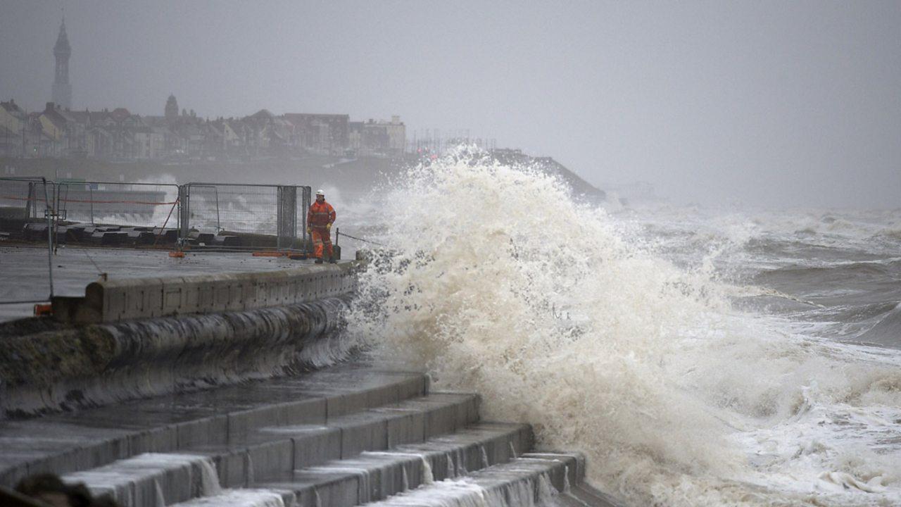 Waves crashing against rocks on a coast line.
