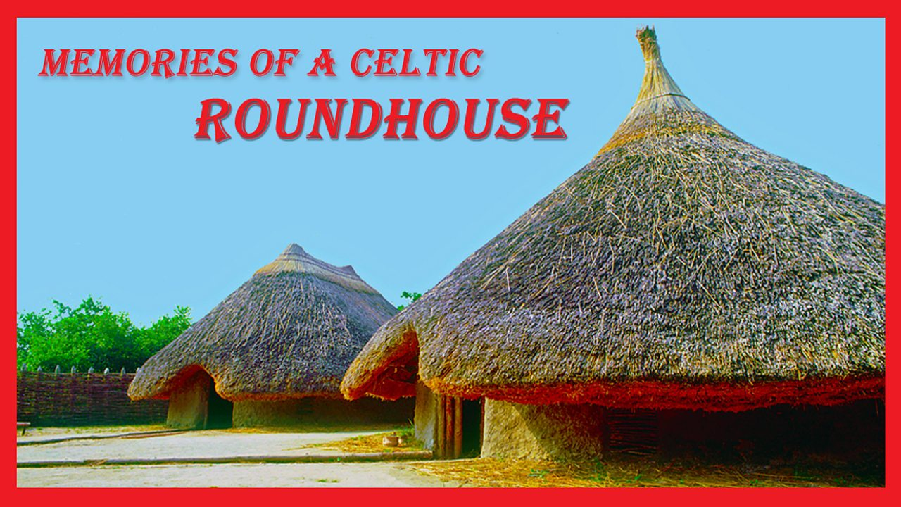 Picture postcard of a Celtic roundhouse, with a large thatched roof.