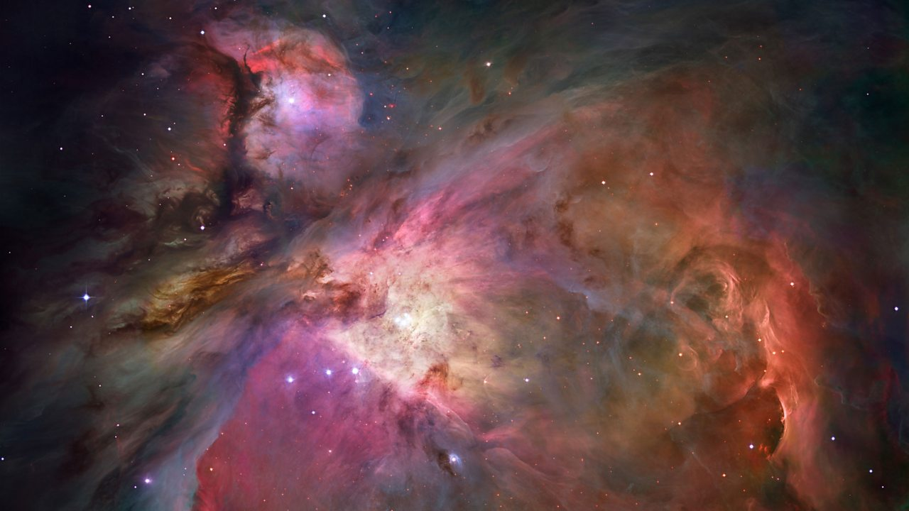 The Orion Nebula. A swirling cloud of gas and dust in space.
