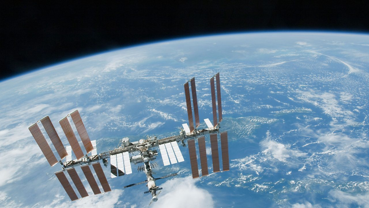 The International Space Station in orbit above the Earth.