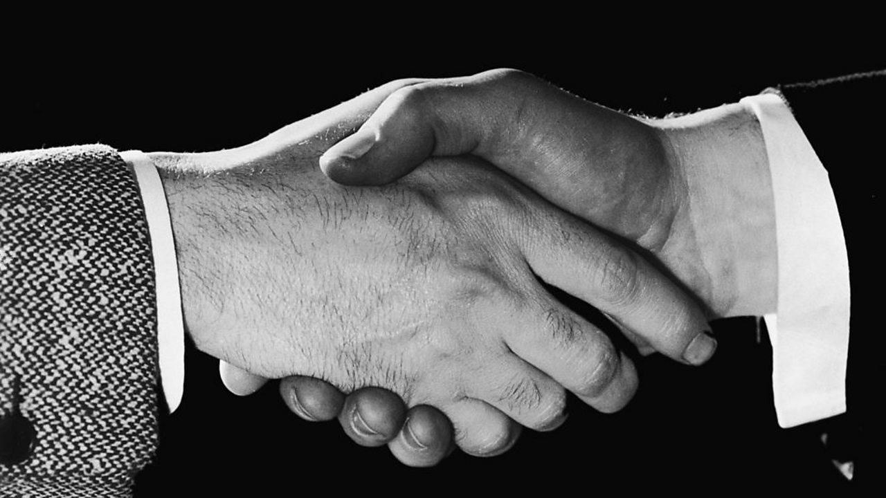 Photo of two hand in a handshake.