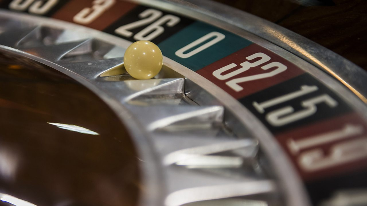 Photograph of a roulette wheel.