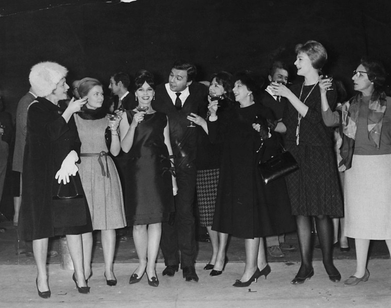 The Royal Shakespeare Company, including Judi Dench (second on left), share a toast in 1961.