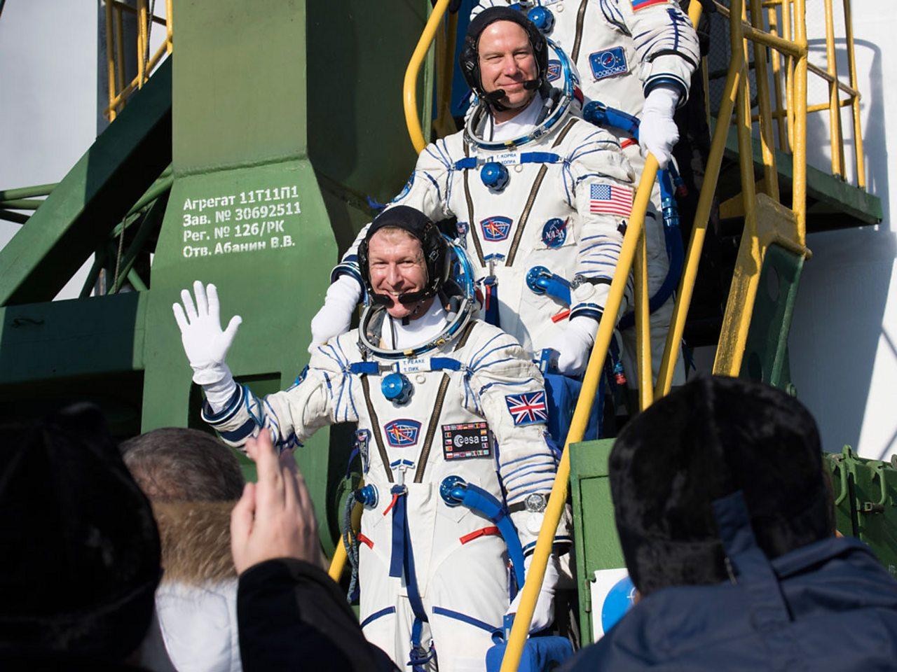 Tim Peake waving goodbye from the steps of the Soyuz rocket.
