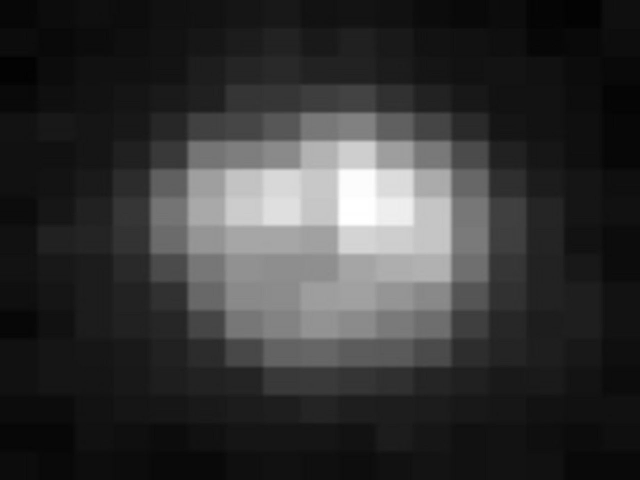 A pixelated photograph of Pluto