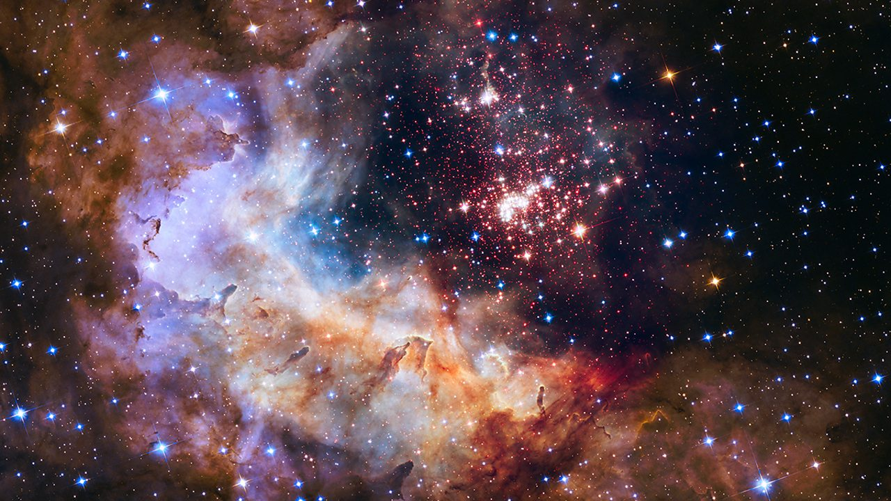 The Hubble telescope uses near-infrared to see through clouds of dust and took this image of the stars and nebula beyond. This allows scientists to learn about the make-up of distant planets and stars, and observe their formation.