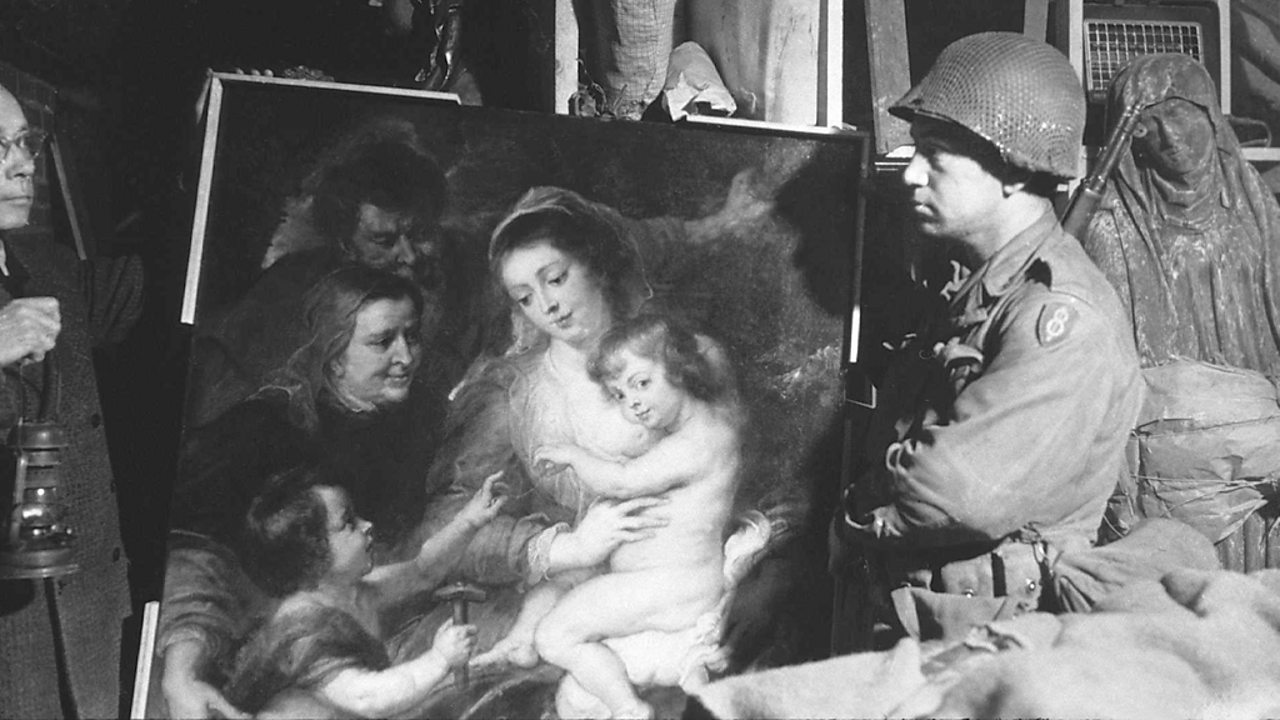 A US soldier inspects priceless art taken from Jews by the Nazis