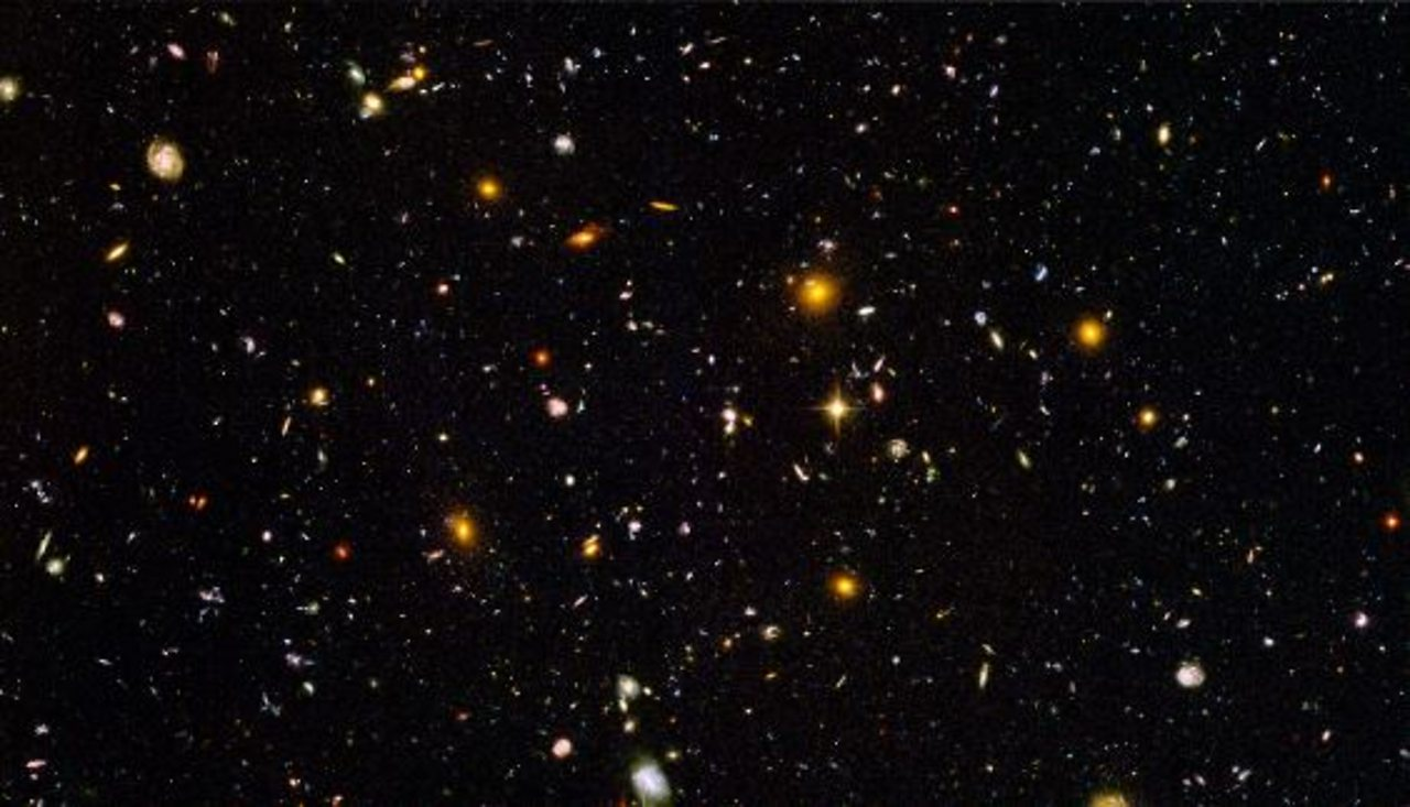 The Hubble Space Telescope was launched in 1990 and has since produced high resolution images of space. This image is a minute fraction of the night sky where each dot is not a star, but a galaxy.