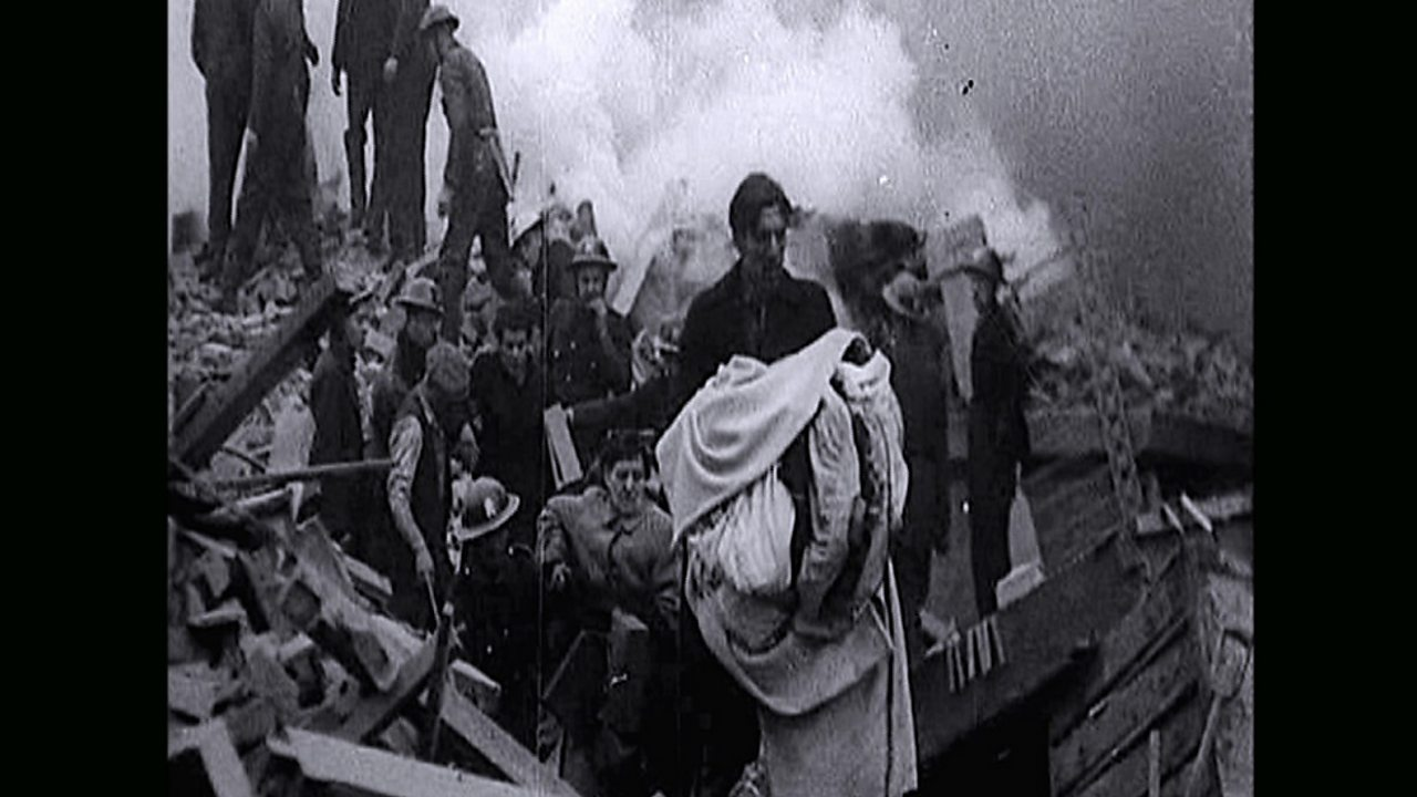 Belfast residents escaping the wreckage of their homes after a bombing raid