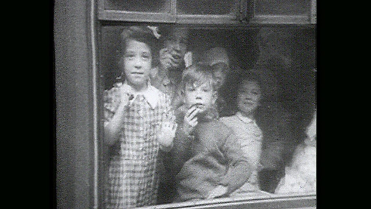 Children leaving their homes on a train