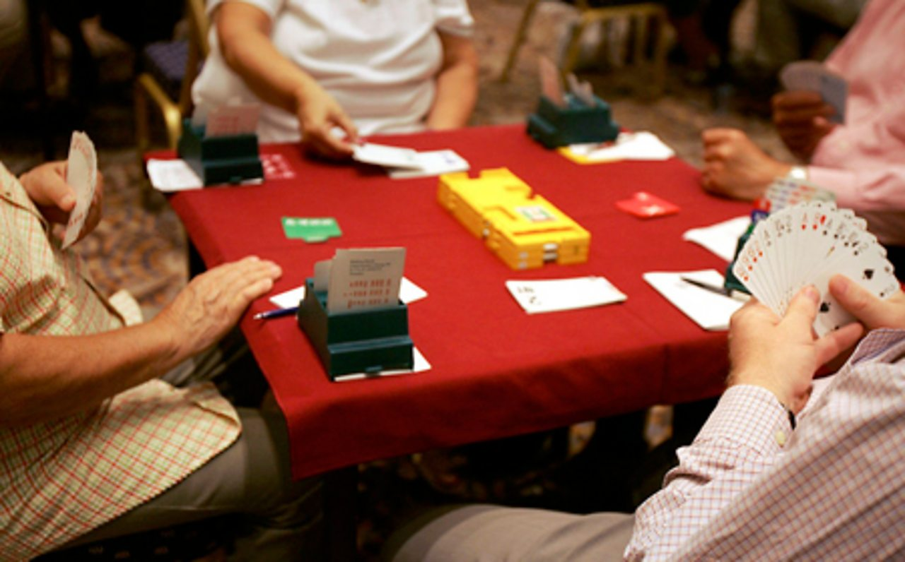 A group of people playing Bridge.