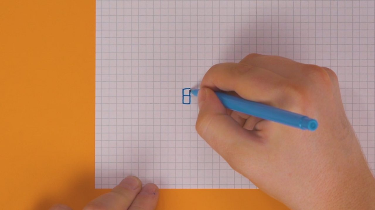 Someone drawing another square on top of a square on squared paper