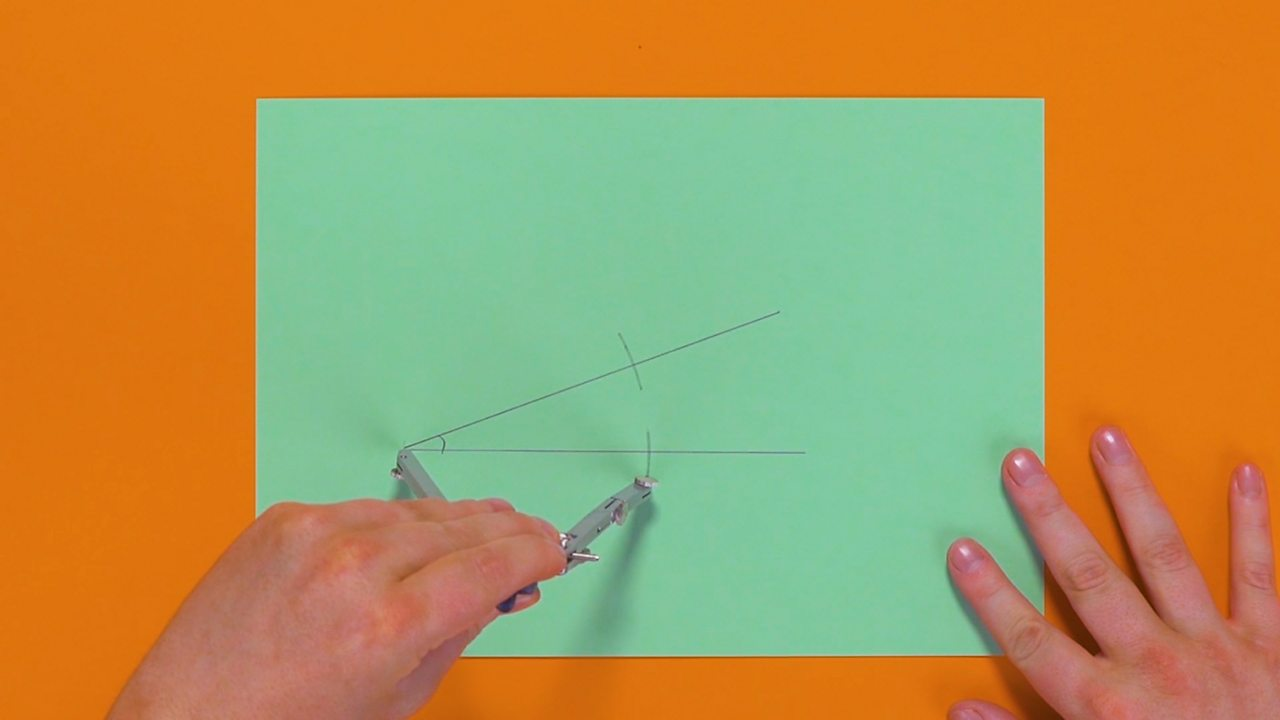 Two small points being drawn across the two lines of the acute angle