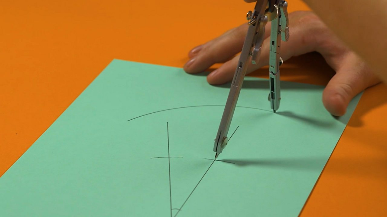 A curve being drawn across one of the two drawn points on the acute angle