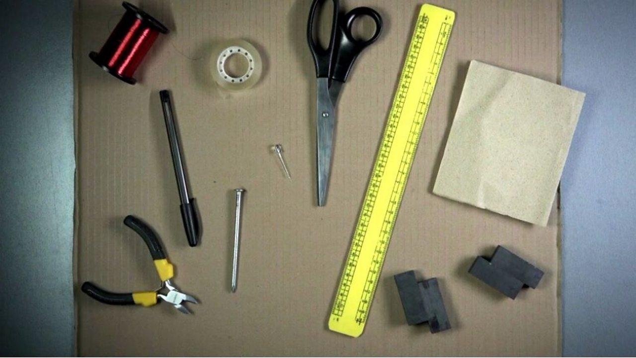An image showing the items needed for the experiment such as a ruler, sandpaper, wire cutters, coil, sellotape, bar magnets and a pen