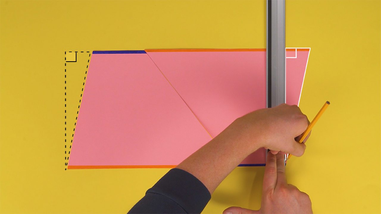 An image showing someone drawing a straight line with a ruler towards the end of the trapezium