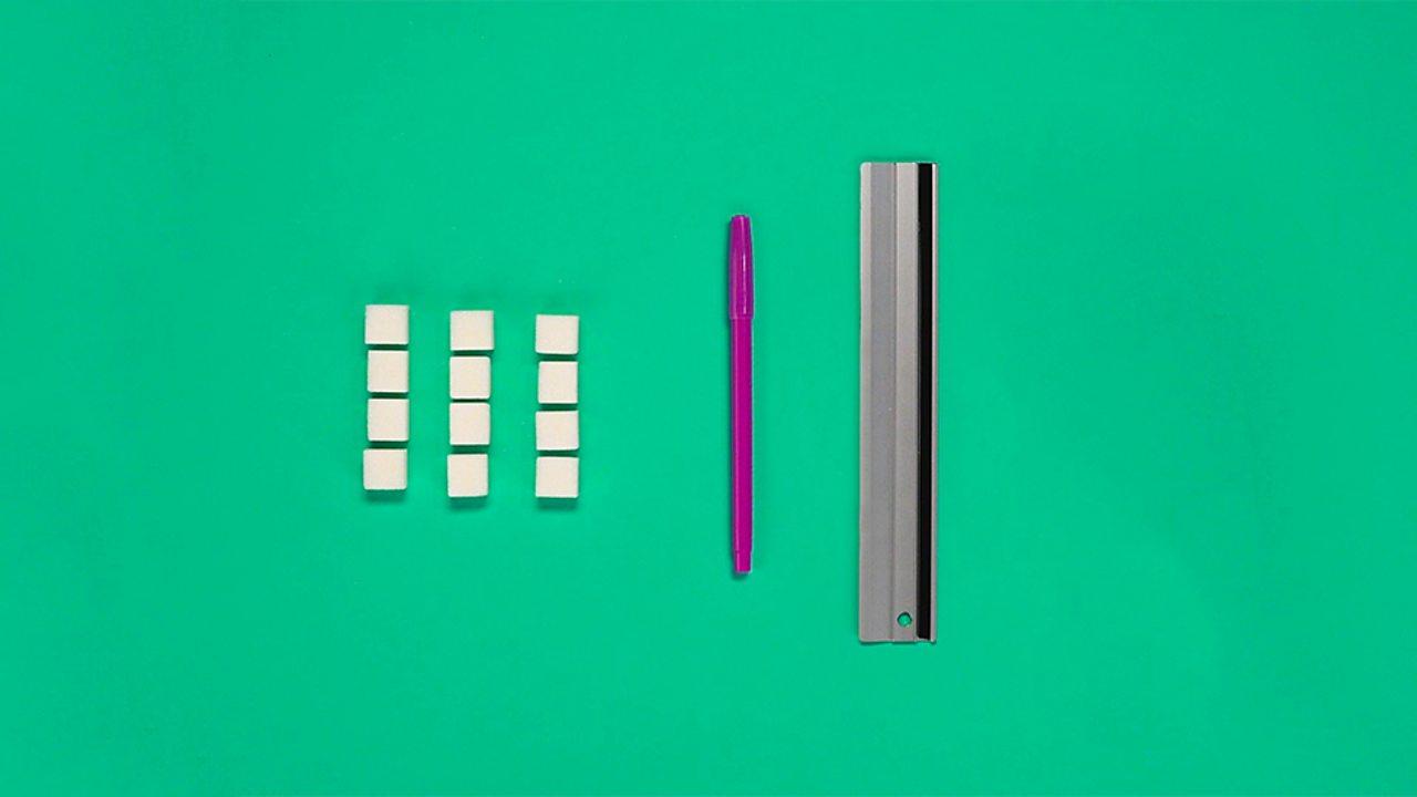 12 cubes, a pen and a ruler