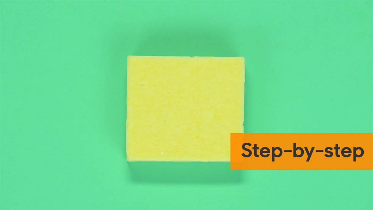 Block of cheese with the step by step graphic at the side