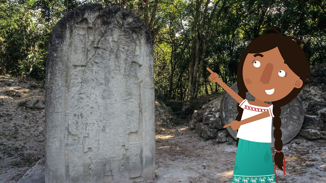 Jade pointing out a commemorative slab.