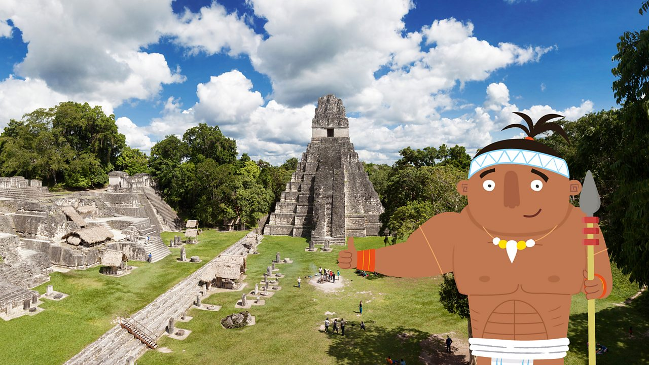 A Maya warrior giving thumbs up in the city of Tikal