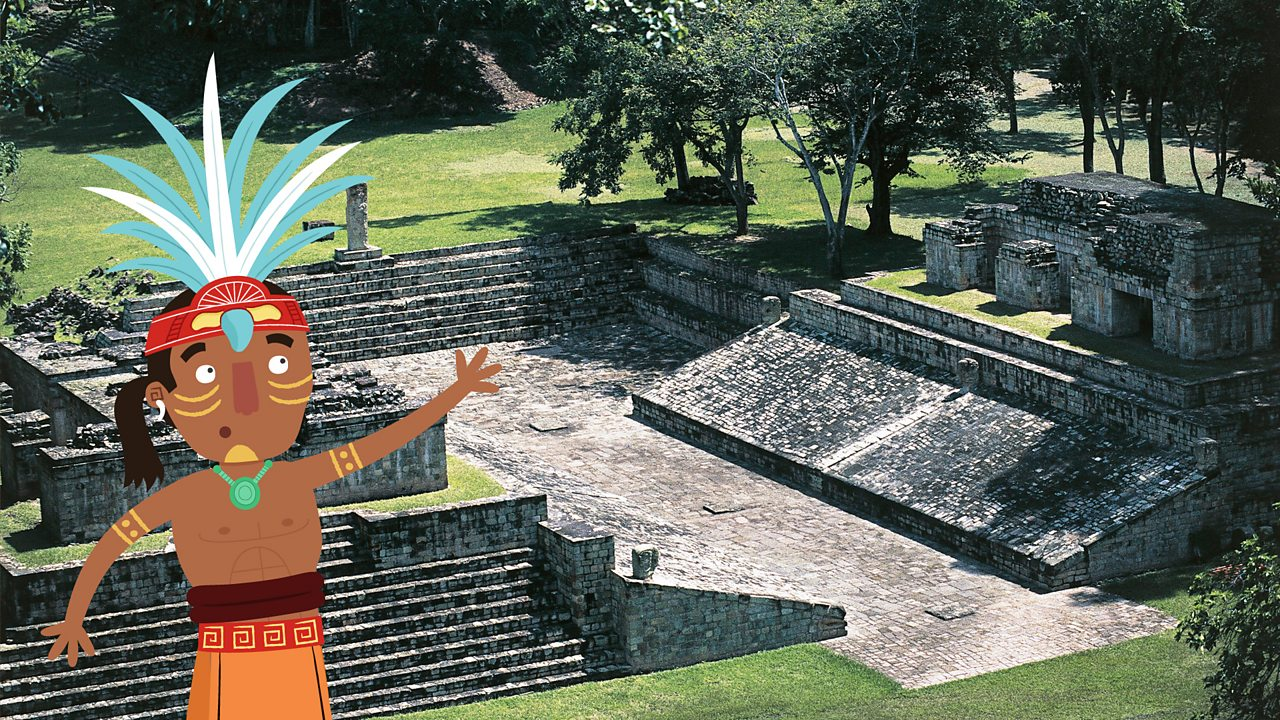 A cartoon figure of a Maya looking out on to a real photographic image of a Maya ball court in Copan