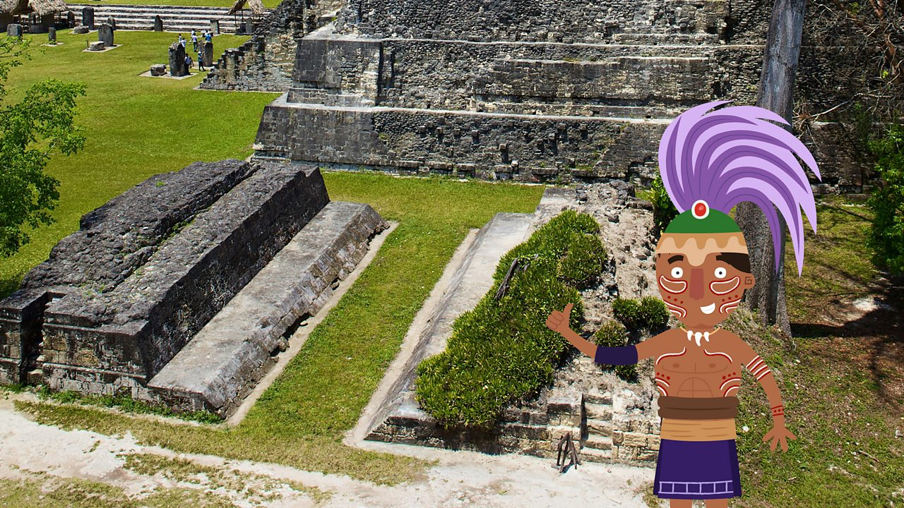 A cartoon figure of a Maya looking out on to a real photographic image of a Maya ball court in Tikal