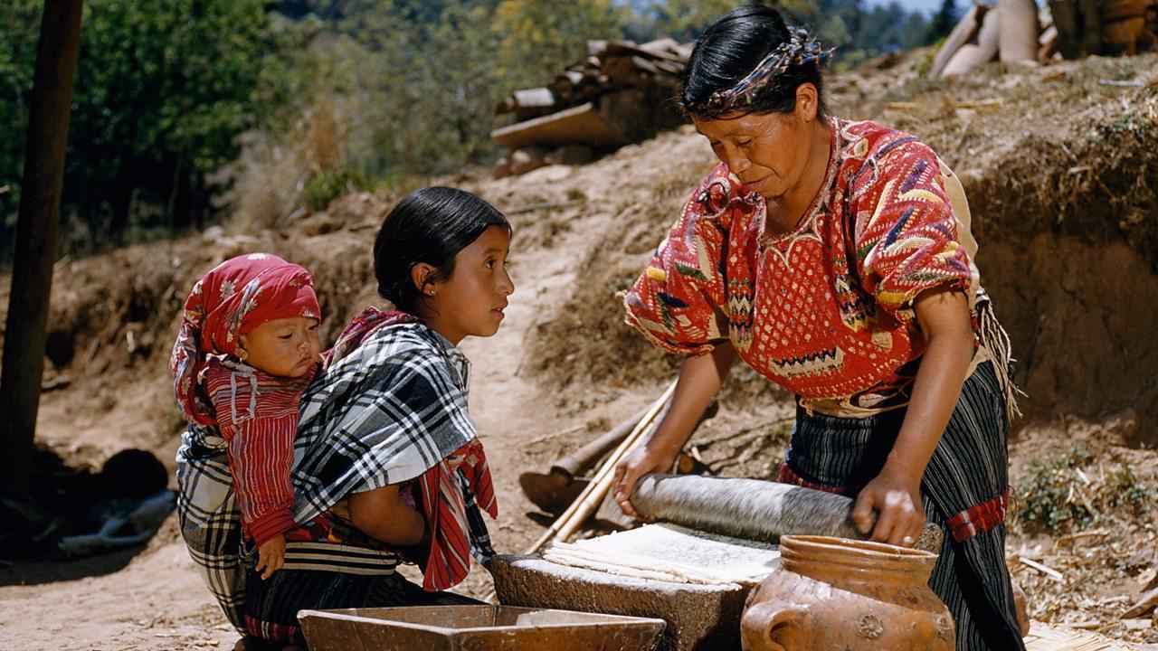 A Maya woman grinding corn
