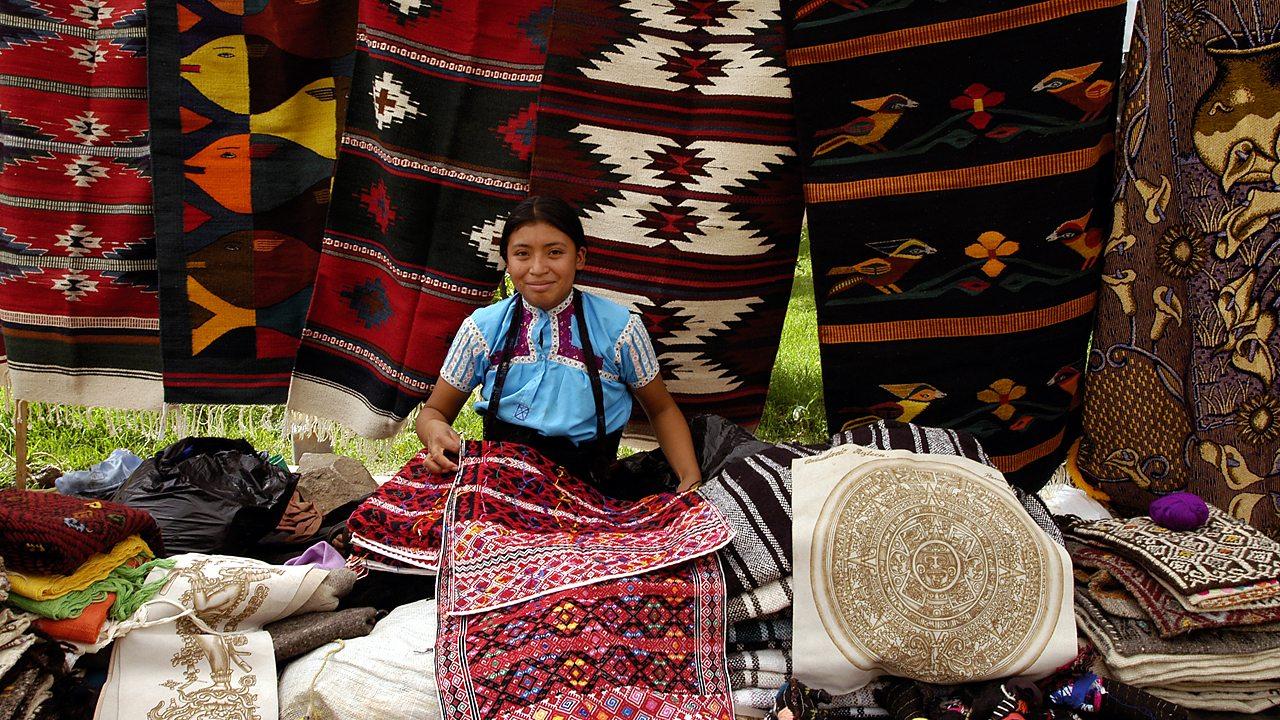A Maya girl selling textiles