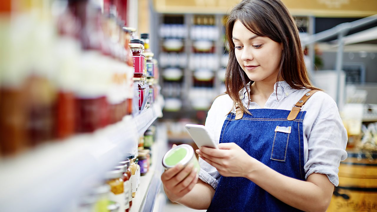Woman checking label on food